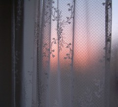 "Sunset through lace curtain over ""garden tub"""