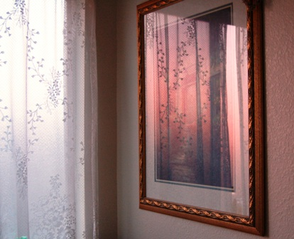 "sunset reflection in painting above ""garden tub"""